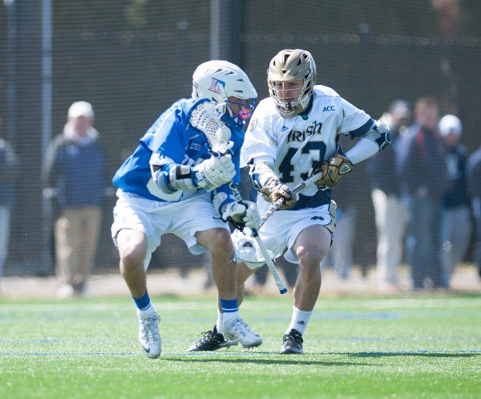 Irish sophomore midfield Matt Landis pursues a Duke ball-carrier during Notre Dame's 15-7 loss to the Blue Devils on April 5. Landis and the Notre Dame defense held Robert Morris to just five goals during a dominating 15-5 victory Saturday at Arlotta Stadium.