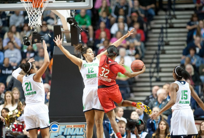 Irish freshman forward Taya Reimer  and senior guard Kayla McBride crash the net in hopes of blocking the layup of Terrapins freshman guard Shatori Walker-Kimbrough. Notre Dame held Maryland to just 67 points Sunday, though the Terps averaged 81.8 points per game this season.