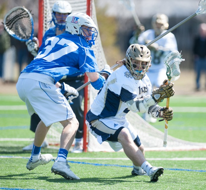 Irish sophomore attackman Matt Kavanagh dodges a Duke defender in Notre Dame's 15-7 loss at the hands of the Blue Devils. Kavanagh added two goals Tuesday, bringing his season total to a team-high 20.