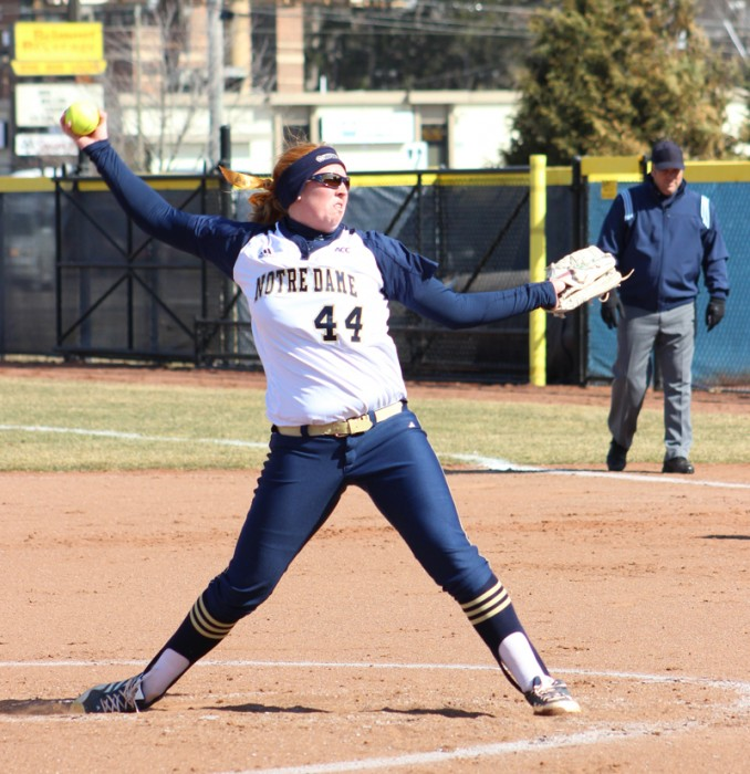 Irish senior pitcher Laura Winter winds up for a pitch during Notre Dame's 11-4 victory over Ball State on Tuesday. Winter earned her 97th win, breaking the previous program record.