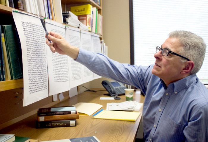Classics professor Joseph Amar examines a copy of the commentary of the Book of Genesis by Jacob of Edessa. Amar said he believes this manuscript was published in the third century.