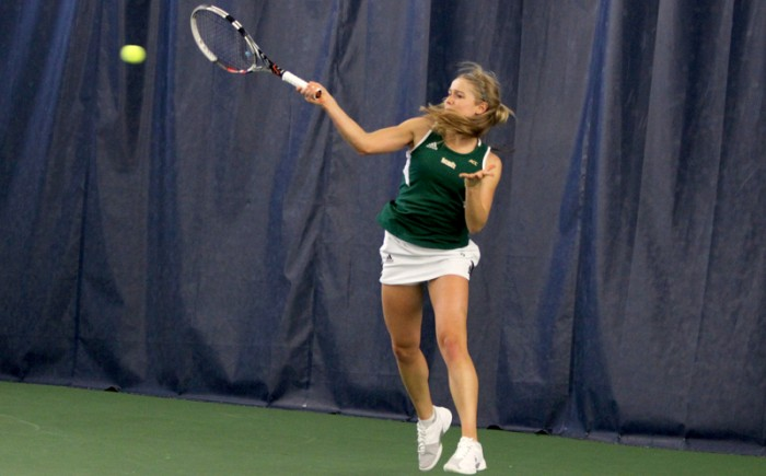 Irish freshman Mary Closs returns a volley Feb. 21 against Georgia Tech. Closs teamed with junior Molly O'Koniewski on Friday to win their first match as a pair, 8-1.