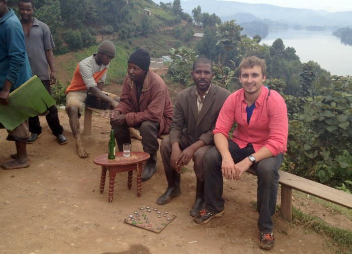 Senior Graham Englert poses with community members around Lake Bunyonyi outside Kabale in southwest Uganda. Englert studied the effects of disease outbreaks on healthcare workers in the region this summer.