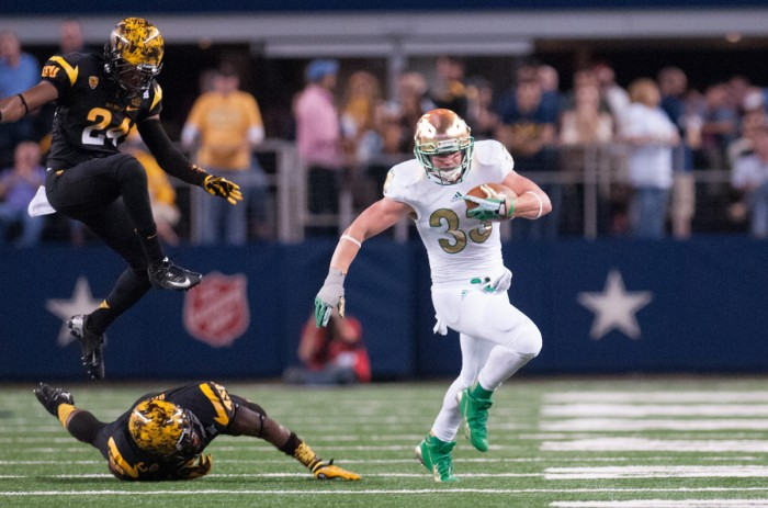 Irish senior running back Cam McDaniel evades two Arizona State defenders during Notre Dame's 37-34 win over the Sun Devils on Oct. 5 at AT&T Stadium in last year's Shamrock Series.