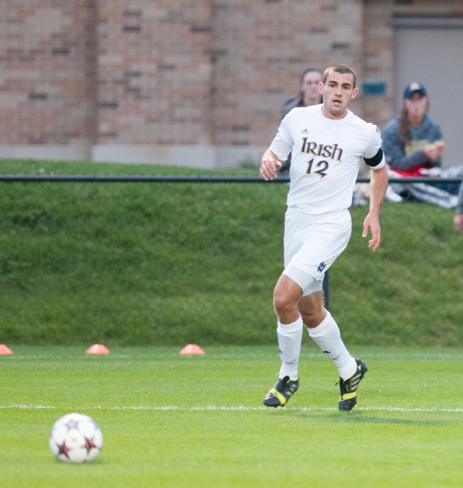 Irish graduate student defender Andrew O'Malley chases the ball during Notre Dame's 3-0 victory over Michigan on Sept. 17 at Alumni Stadium.