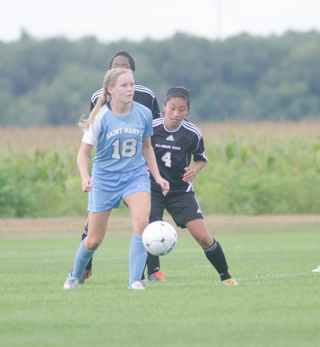 Saint Mary's midfielder Maggie McLaughlin wards off defenders during the Belles'  4-1 victory over Illinois Tech on Sept. 2. McLaughlin started 19 games for the Belles in 2013.