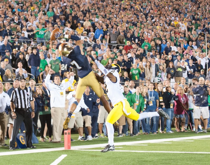 Irish sophomore receiver Will Fuller leaps to haul in a touchdown pass from senior quarterback Everett Golson during Notre Dame's 31-0 win over Michigan on Saturday night at Notre Dame Stadium.