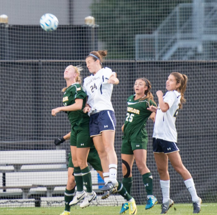 Irish junior defender Katie Naughton heads a shot over the defender during Notre Dame's 1-0 victory over Baylor on Friday.