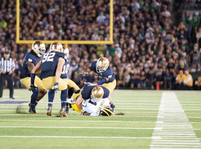 Irish freshman defensive lineman Grant Blankenship runs towards the scrum during Notre Dame's 31-0 win over Michigan on Sept. 6.