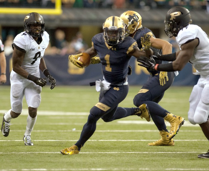 Junior running back Greg Bryant eludes a defender during Notre Dame's 30-14 win over Purdue on Sept. 13. Bryant will miss the entire 2015 season, head coach Brian Kelly said in a statement Tuesday.