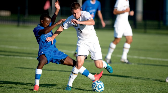 Irish junior midfielder Connor Klekota tries to evade a Kentucky defender during Notre Dame's 1-0 loss to the Wildcats on Sept. 8.