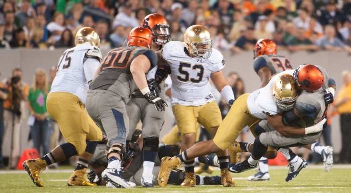 Irish junior defensive end Romeo Okwara swallows up the Syracuse ball-carrier during Notre Dame's 31-15 win over the Orange on Saturday at MetLife Stadium.