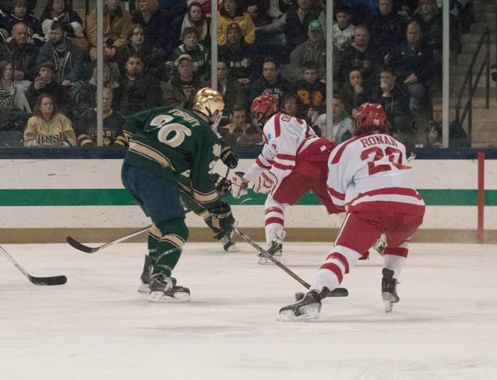 Irish junior captain Steven Fogarty surveys the offensive zone against Boston University on Feb. 22 at Compton Family Ice Arena.
