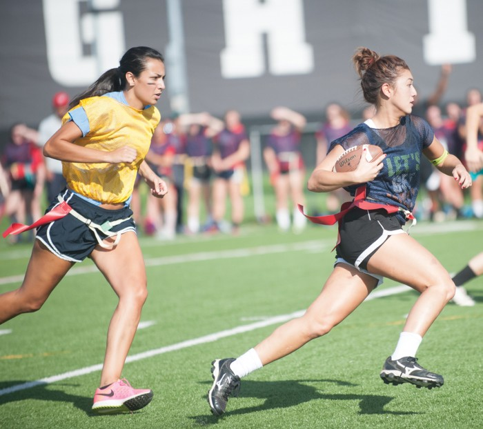 A Pasquerilla East player runs away from a pursuing Howard player during the Pyros' 21-19 win Sunday at Labar Practice Fields.