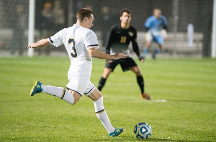 Irish junior midfielder Connor Klekota pushes the ball upfield in Notre Dame's win against VCU on Tuesday at Alumni Stadium.