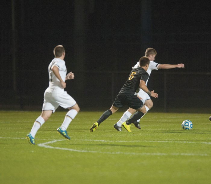 Irish freshman forward Jon Gallagher races towards the ball in a 1-0, double-overtime victory against VCU on Tuesday at Alumni Stadium. Gallagher recorded one shot in Friday's loss to Boston College.