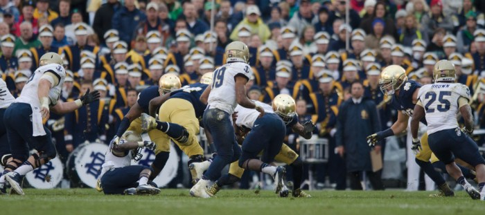 Navy junior quarterback Keenan Reynolds (19) directs the prolific Midshipmen triple option rushing attack against the Irish in Notre Dame's 38-34 win over the Midshipmen in 2013 at Notre Dame Stadium. Reynolds has rushed for 639 yards and 11 touchdowns in six games this season.