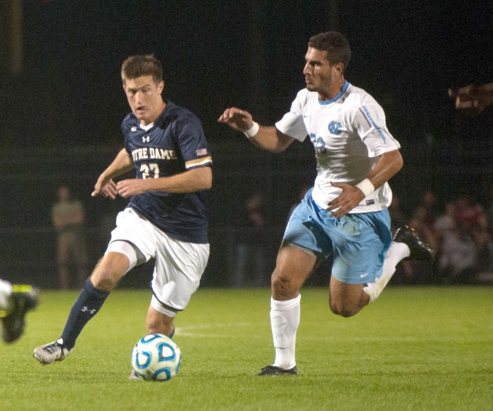 Irish junior midfielder Patrick Hodan dribbles past a North Carolina defender during Notre Dame's 2-0 victory over the Tar Heels on Sept. 26.