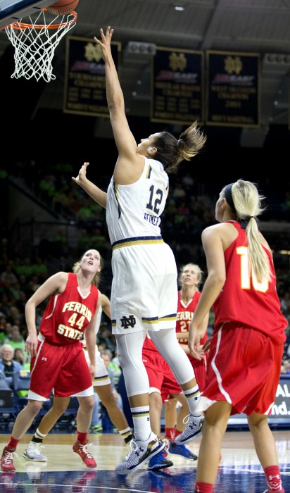Irish sophomore forward Taya Reimer goes up for a rebound during Notre Dame's win over Ferris State on Wednesday night.