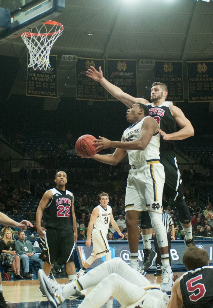 Freshman forward Bonzie Colson leaps for a layup during Notre Dame's exhibition victory against Lewis on Friday at Purcell Pavilion.