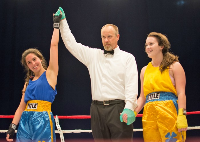 Senior Ava Stachelski, left, is declared the winner by unanimous decision after her semifinal bout with junior Caitlyn Beauchamp on Tuesday night at Joyce Center Fieldhouse.