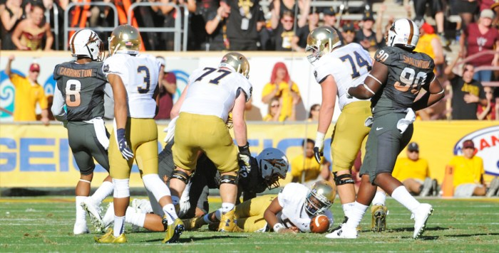 Irish senior quarterback Everett Golson falls to the ground during Notre Dame's 55-31 loss to Arizona State on Saturday at Sun Devil Stadium in Tempe, Arizona.