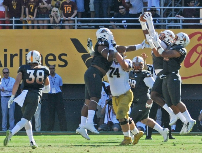 A host of Arizona State defenders reach for a deflected pass during Arizona State's 55-31 victory over Notre Dame on Saturday. The Irish committed five turnovers in the loss.