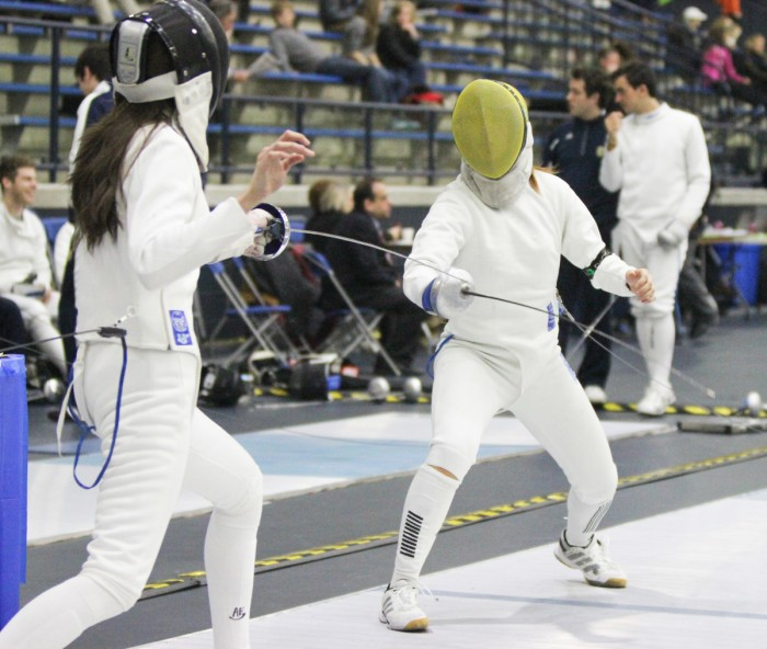 Irish senior epee Nicole Ameli, right, duels with an opponent Feb. 9 during the DeCicco Duals at the Castellan Family Fencing Center.