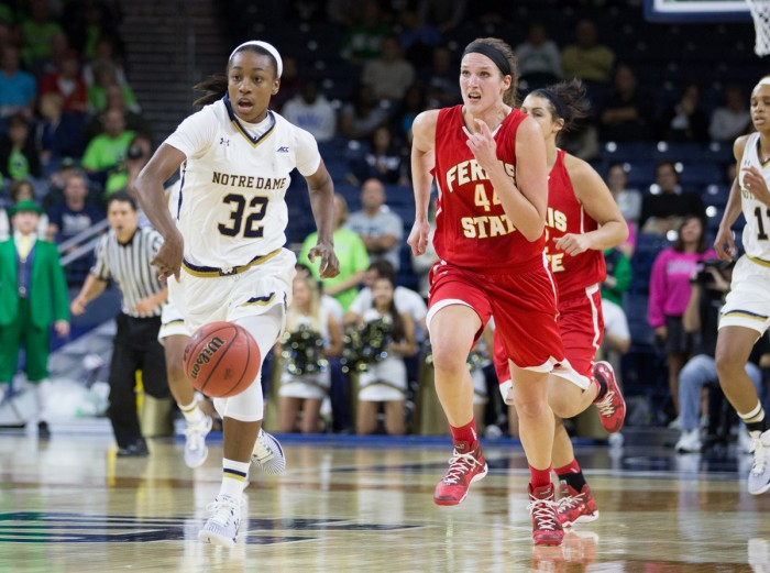 Notre Dame junior guard Jewell Loyd dribbles the ball up the court during Notre Dame's 92-32 exhibition victory over Ferris State at Purcell Pavilion on Nov. 5. Loyd had 11 rebounds and led all scorers with 28 points during the Irish victory over Michigan State on Wednesday.