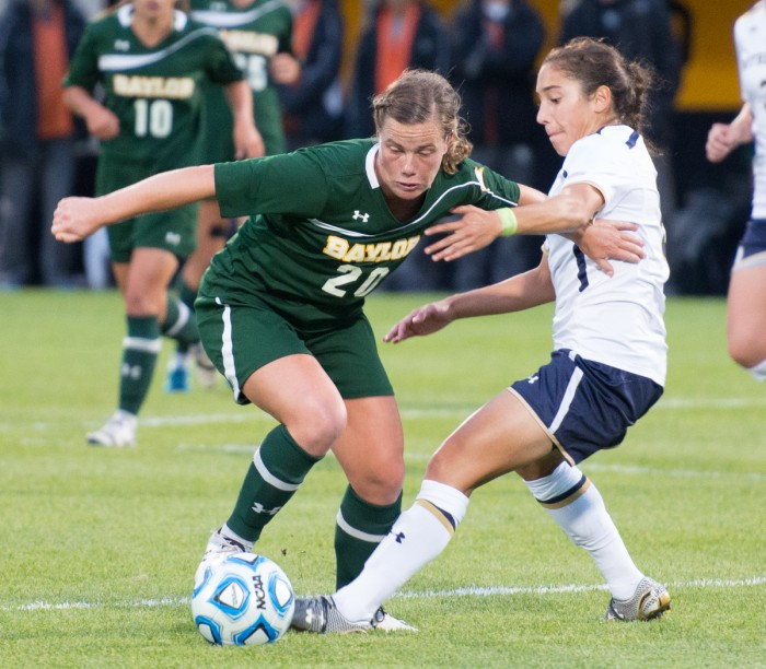 Irish freshman defender Sabrina Flores tangles with a Baylor forward during Notre Dame's 1-0 win over the Bears on Sept. 12.