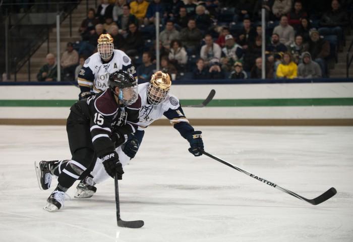 Irish senior defenseman Robbie Russo skates alongside an attacker during Notre Dame's 3-2 overtime loss to Union College on Nov. 28.