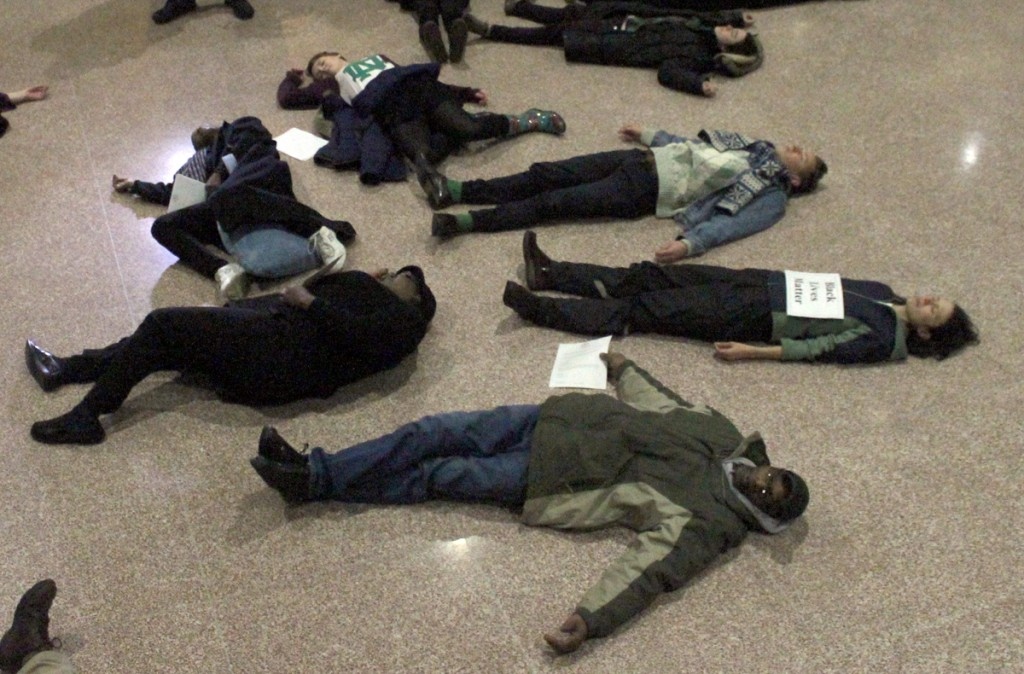 "Notre Dame students and South Bend community members ""die in"" at the South Bend city council building on Monday to protest racism."
