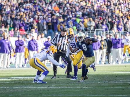 Irish quarterback Malik Zaire attempts to evade defenders.