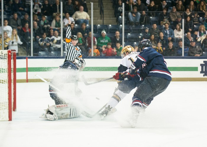 Irish junior left wing and alternate captain Sam Herr fires off a shot in a 3-3 tie at home with Connecticut on Jan. 16.