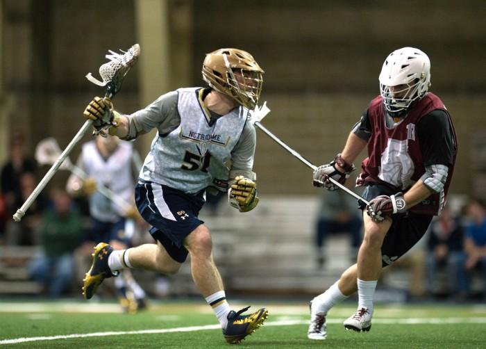 Notre Dame junior attacker Matt Kavanagh maneuvers around Bellarmine's defense in an exhibition match at Loftus Sports Center on Sunday.  Kavanagh tallied 42 goals last season.