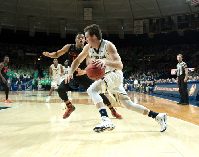 Irish senior guard/forward Pat Connaughton drives past a defender during Notre Dame's 75-70 victory over Miami on Jan. 17 at Purcell Pavilion. Connaughton finished the game with 10 points and 11 rebounds.