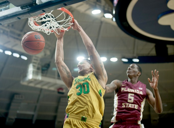 Irish junior forward Zach Auguste slams down a dunk during Notre Dame's 83-63 win over Florida State on Dec. 13 at Purcell Pavilion. Auguste led all scorers in the game with 26 points.