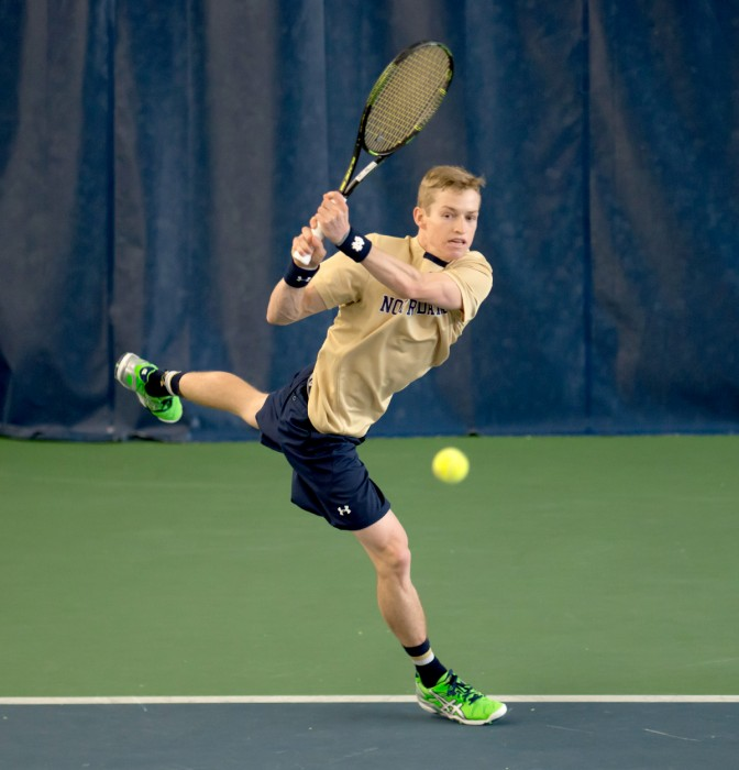 Notre Dame sophomore Josh Hagar follows through on a shot during a 4-3 win over Oklahoma State on Jan. 24 at Eck Tennis Center.