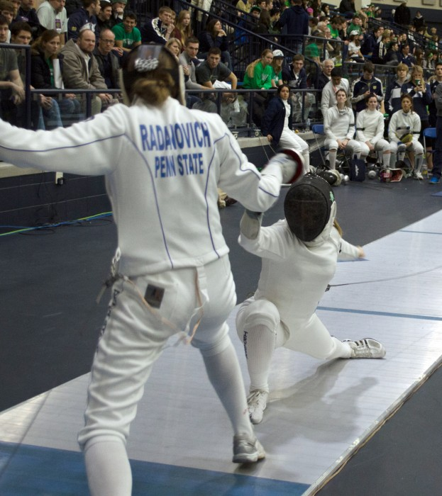 Irish junior epee Catherine Lee faces Penn State sophomore Jessie Radanovich during the DeCicco Duals on Feb. 8 at Castellan Family Fencing Center.
