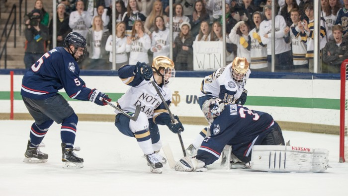 Freshman Anders Bjork tries to knock in a rebound during Notre Dame's 3-3 tie against Connecticut on Jan. 16.