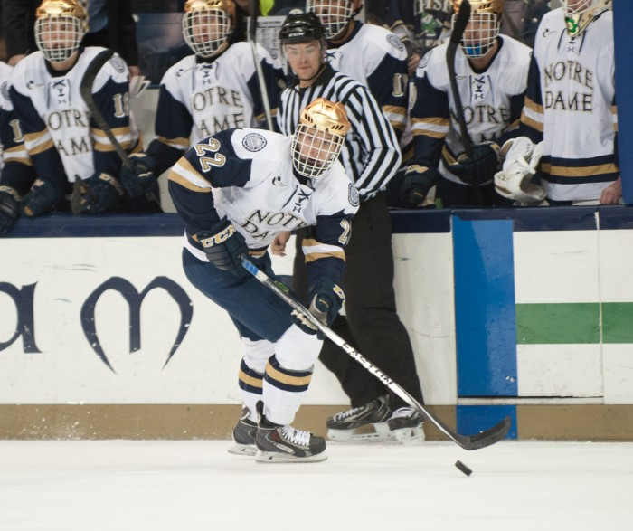 Irish junior left wing Mario Lucia scans the ice Nov. 21 during Notre Dame's  2-2 tie with UMass-Lowell at Compton Family Ice Arena.
