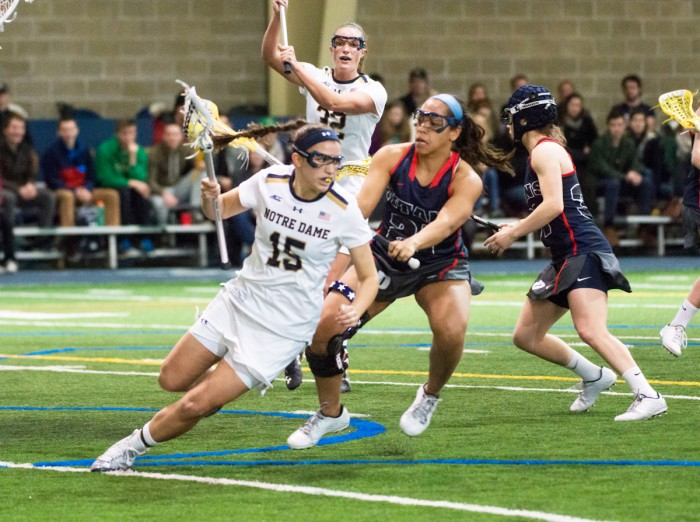 Irish sophomore attack Cortney Fortunato spins away from a  defender during Notre Dame's 17-5 win over Detroit on Sunday.