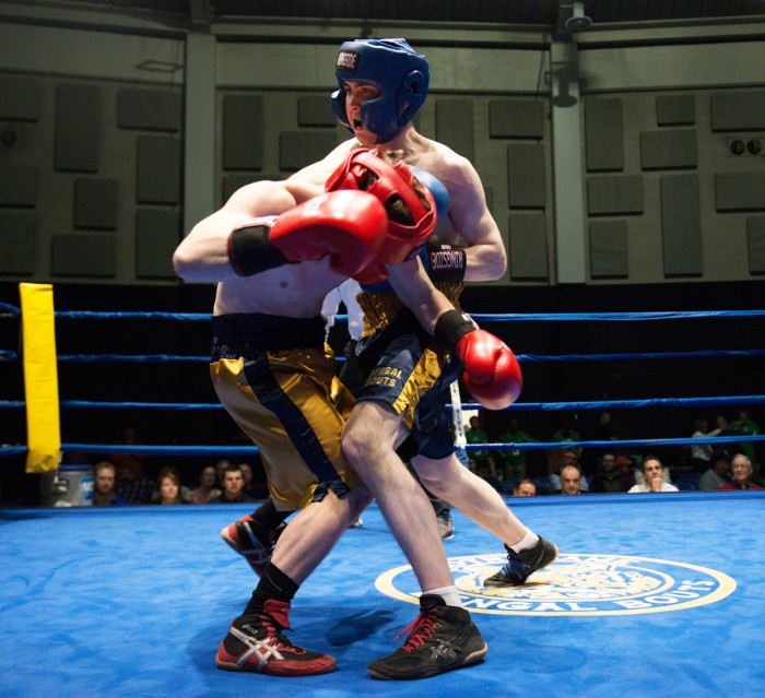 """Sophmore Patrick """"Il Lupo""""  Brennan, left, is declared the winner in his semifinal bout against junior EJ """"Binks"""" Leppert on Wednesday night."""