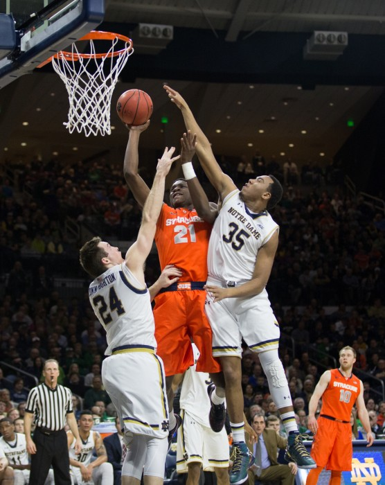 Senior Pat Connaughton, left, and freshman Bonzie Colson try to block a Syracuse shot in Tuesday's loss at Purcell Pavilion.