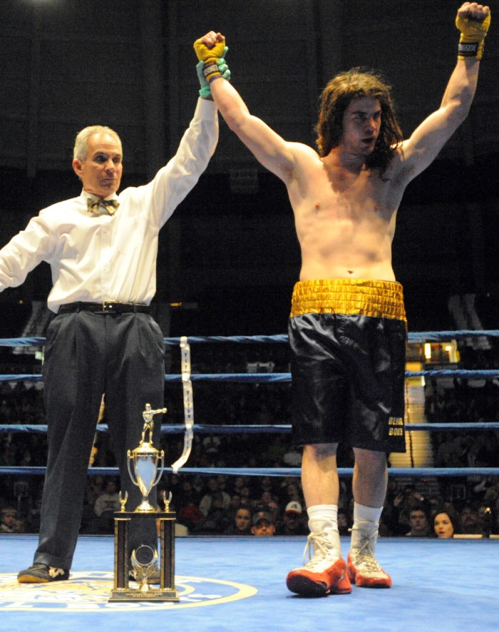Senior Garrity McOsker celebrates after winning the 2014 Bengal Bouts title in the 162-pound weight class.