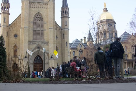 Visitors await outside The Basilica of the Sacred Heart before the Paschal Vigil Mass on Saturday.
