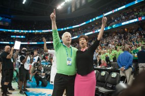 Irish head coach Muffet McGraw and her husband, Matt, sing the Alma Mater to celebrate Notre Dame's win to advance to its second consecutive national championship game.