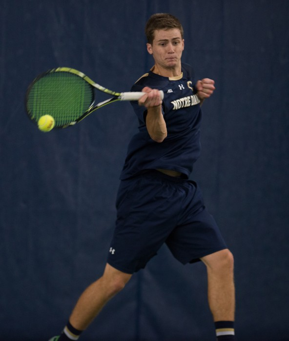 Irish junior Quentin Monaghan follows through on a shot in a  4-3 victory against Oklahoma State on Jan. 24 at Eck Tennis Pavilion.