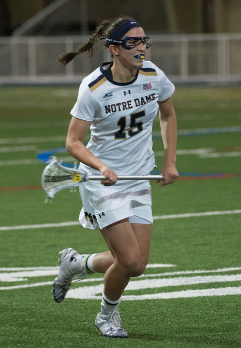 Irish sophomore attack Cortney Fortuno surverys the field in an 17-5 victory against Detroit  on Feb. 15 at Loftus Sports Center. Fortunado has 42 goals and 14 assists this season.