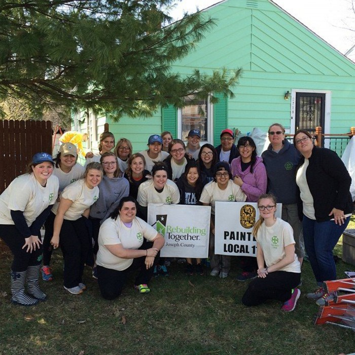 Saint Mary's students participate in Rebuilding Together, rehabing housing and working in the South Bend community.